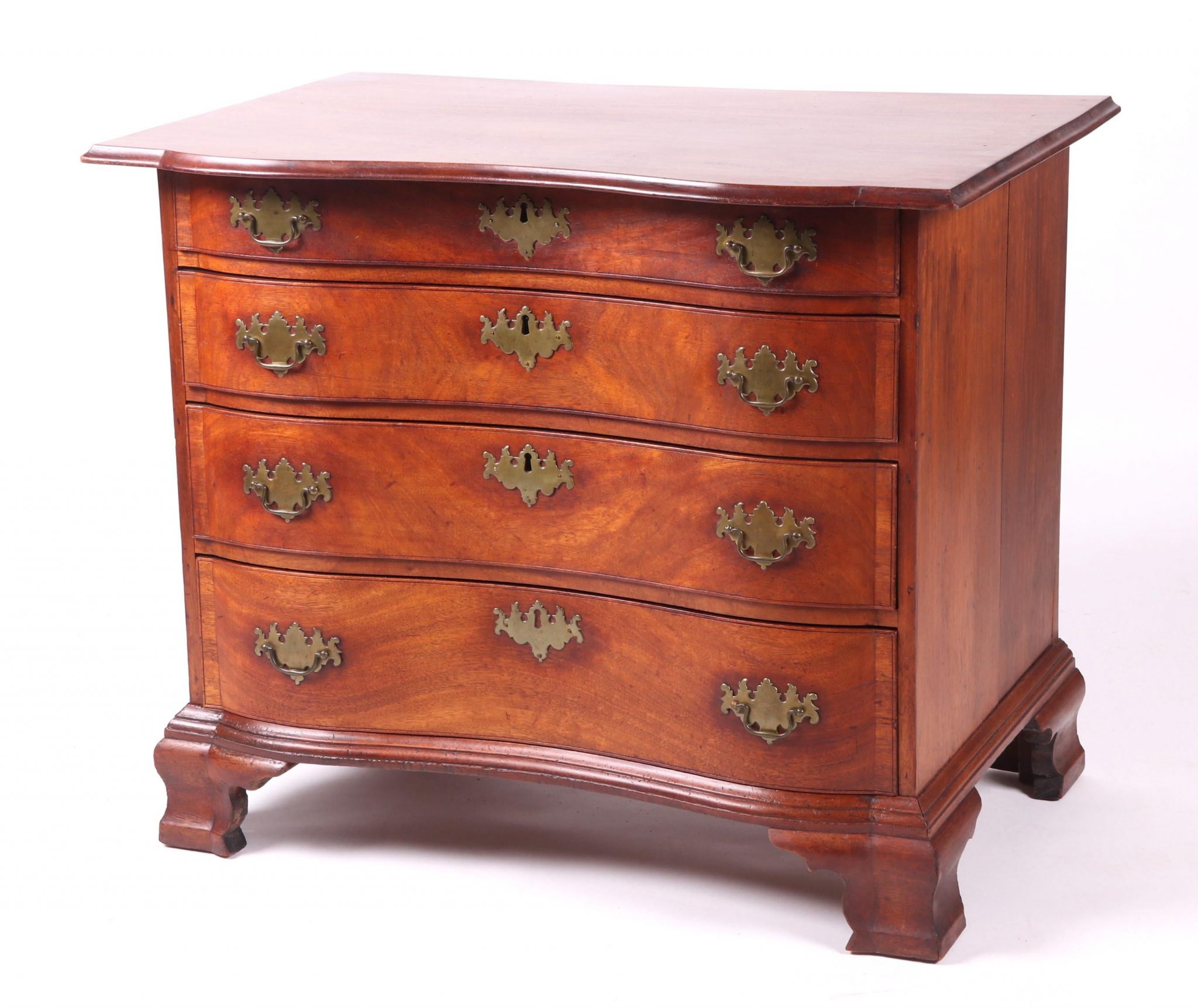1019011: Reverse Serpentine Blockfront Chest of Drawers, Realized $12,500